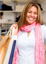 Very happy female shopper smiling store Royalty Free Stock Photography