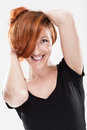Very happy redhead woman with sexy expression and smiling while playing her hair Royalty Free Stock Images