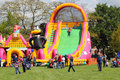 Very large inflatable childrens slide a at an outdoor event in the summer time this photograph was taken at the annual kite Royalty Free Stock Photo