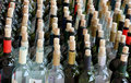 Very much stacked up wine bottles  with  corks Royalty Free Stock Photo