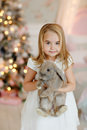 Very nice charming little girl blonde in white dress laughs and