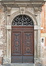 Very old beautiful door in italy tuscany Royalty Free Stock Image