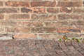 Very old brick wall texture background with stone street Stock Photo