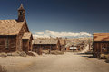 Very old colored vintage photo with abandoned western saloon building in the middle of a desert Royalty Free Stock Photo