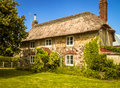A Very Old English, Thatched, Country Cottage Royalty Free Stock Photo