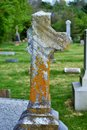 Very old moss covered broken statue / headstone in a cemetery