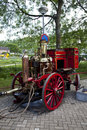 Very old red fire engine on street Royalty Free Stock Photo