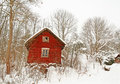Very old red wooden house in a snowy forest Royalty Free Stock Photo