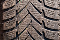 Very old used black tyre macro photo Stock Photo