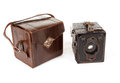 Very old vintage camera on white background isolated with transporting box Royalty Free Stock Images