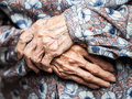 Very old woman hands aging process senior wrinkled skin Royalty Free Stock Image