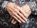Very old woman hands aging process wrinkled skin Royalty Free Stock Image