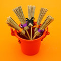 Very orange shot with brooms in a bucket Royalty Free Stock Photo
