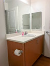 Simple bathroom vanity with mirrors and sink Royalty Free Stock Photo