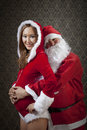 Very special new year santa claus and mrs santa is excited with their pregnancy Royalty Free Stock Images