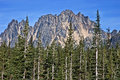 Very steep rugged mountain summer evergreen forest foreground bright clear skies taken liberty bell mountain washington state off Stock Photos