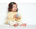Very surprised little child girl sit on white towel. Emotion and face expression. Royalty Free Stock Photo