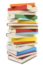 Tall stack of books, vertical, isolated white background Royalty Free Stock Photo