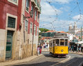 Very touristic place in the old part of Lisbon, with a traditional tram passing by in the city of Lisbon, Portugal. Royalty Free Stock Photo