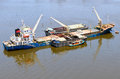 Vessel bulk cargo with crane and lighter beside boat in the river Stock Photography