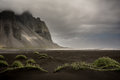 Vestrahorn mountains of the in iceland with cloud holding on top Royalty Free Stock Photo