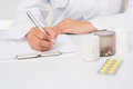 Vet writing on clipboard the prescriptions Royalty Free Stock Photo