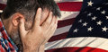 Veteran portrait of an elderly man with face closed by hand on usa flag background Stock Image
