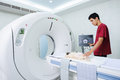 Veterinarian doctor with mri computer control at hospital Stock Image
