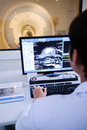 Veterinarian doctor working in mri room with computer control Stock Images