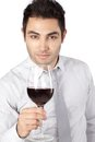 Vetro di holding red wine dell uomo d affari Immagine Stock