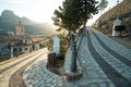 Via crucis old winding uphill with a chruch tower in the background Stock Photo