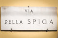 Via della spiga ensign in milan marble indicating one of the most famous street of italy situated the so called quadrangle of Royalty Free Stock Photo