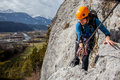 Via ferrata climbing young woman high above valley Royalty Free Stock Images