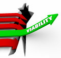 Viability arrow rises possible potential success feasibility word on a green jumping over a crack or hole to illustrate or or Royalty Free Stock Image