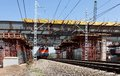 Viaduct and the train construction of new under railways without stopping rail traffic in russia Stock Photography