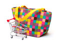 Vibrant Cloth Ladies Handbag with Shopping Cart Stock Photography