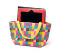Vibrant Cloth Ladies Handbag with Tablet PC Royalty Free Stock Photography