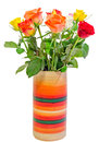 Vibrant colored (red, yellow, orange, white) roses flowers in a colored vase, close up, bouquet, floral arrangement Royalty Free Stock Photo
