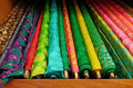 Vibrant colored textured fine silk cloth material rolls Royalty Free Stock Photo