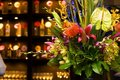 Vibrant flower arrangement in an upscale bar Royalty Free Stock Photography