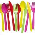 Vibrant forks, kives, spoons Royalty Free Stock Photo
