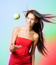 Vibrant healh girl with levitating apple. Stock Photography
