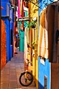 Vibrant italian street colorful in burano venice italy Stock Images