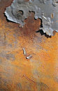 Vibrant rust with a flaky paint accent sunlit piece of rusty metal Royalty Free Stock Photos