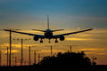 Vibrant sky colors an airplane landing at dusk on the runway the turns beautiful with the gradient of during Stock Image