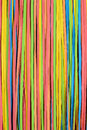 Vibrant small rubber strips arranged vertical pattern vertical frame Royalty Free Stock Photos