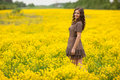 Vibrant yellow canola field and cheerful girl spring feeling from latvia baltic states Stock Images