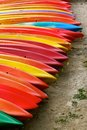 Vibrantly colourful kayaks in benodet seeking paddles the touristy town of france for a river or a sea cruise Royalty Free Stock Images