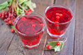 Viburnum drink in the glass and on a table Stock Photography