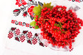 Viburnum on embroidered cross stitch pattern top view in a plate Stock Image